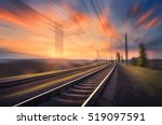 railroad in motion at sunset.... | Shutterstock . vector #519097591
