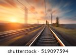 railroad in motion at sunset.... | Shutterstock . vector #519097594