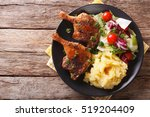roasted duck leg with mashed... | Shutterstock . vector #519204409