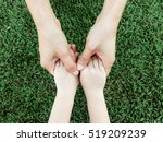 hand hold hand.mother holding... | Shutterstock . vector #519209239