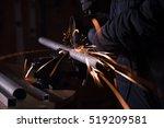 metalworker cutting metal pipe... | Shutterstock . vector #519209581