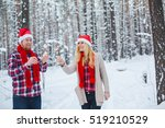 young couple in christmas hats... | Shutterstock . vector #519210529