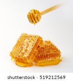 sweet honeycomb and wooden dish ... | Shutterstock . vector #519212569