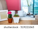 Small photo of Photo frame, cactus, succulent pots & coffee cup decoration on wooden table / Interior plants for air pollution abatement concept