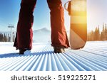 snowboarder stands on slope... | Shutterstock . vector #519225271