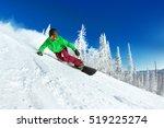 Active Man Snowboarder Riding...