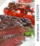 beef steak on a plate  a close... | Shutterstock . vector #519242374