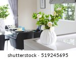 Decorative Vases And Plant On...