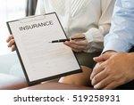 insurance agent holding pen ... | Shutterstock . vector #519258931