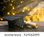 Small photo of graduation cap, hat with degree paper on wood table, abstract light background Empty ready for your product display or montage.