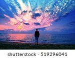 silhouette of man on the beach... | Shutterstock . vector #519296041
