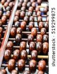 Small photo of Old abacus on wooden background.