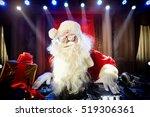 dj santa claus at christmas... | Shutterstock . vector #519306361