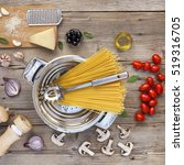 ingredients on a wooden table.... | Shutterstock . vector #519316705