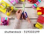 woman wrapping modern christmas