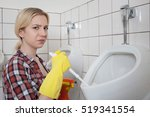 young blonde woman cleaning a... | Shutterstock . vector #519341554