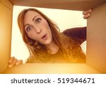 woman looking surprised into a... | Shutterstock . vector #519344671