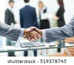 business partners shake hands... | Shutterstock . vector #519378745
