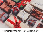 Lots Of Gift Boxes On Wood...