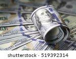 roll of hundred dollar bill on... | Shutterstock . vector #519392314