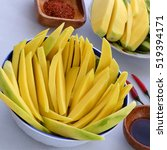 Small photo of Vietnamese fruit, green mango cut in slice, a popular tropical fruit, rich vitamin A, vitamin C, collagen, good for health and impulse calcium absorption