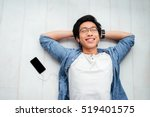 asian man in shirt on the floor.... | Shutterstock . vector #519401575