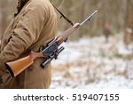 hunter in camouflage with rifle.... | Shutterstock . vector #519407155