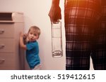Small photo of Cropped shot of drunk mother with bottle and frightened son hiding in corner. Alcohol abuse. Domestic violence.