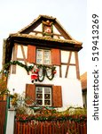 Small photo of Typical rural half-timbered house decorated for Christmas. Alsace, France.
