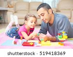 father and little daughter are... | Shutterstock . vector #519418369
