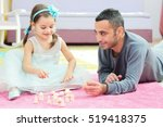 Father And Little Daughter Playing With Toys Together At Home - stock photo