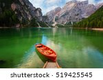 boats on the braies lake  ... | Shutterstock . vector #519425545