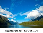Clouds over Lake Manapouri, New Zealand - stock photo