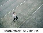 top view of sporty man running... | Shutterstock . vector #519484645