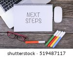 next steps text on wooden desk... | Shutterstock . vector #519487117