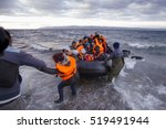 Small photo of Lesvos island, Greece - 29 October 2015. Syrian migrants / refugees arrive from Turkey on boat through sea with cold water near Molyvos, Lesbos on an overload dinghy. Leaving Syria that has war