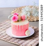 a small homemade cake with pink ... | Shutterstock . vector #519492889