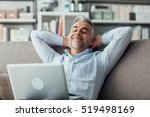 happy businessman relaxing at... | Shutterstock . vector #519498169