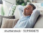 handsome businessman relaxing... | Shutterstock . vector #519500875