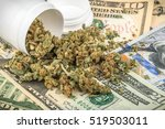 marijuana buds on money | Shutterstock . vector #519503011