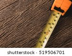 measurement tape on grunge wood ... | Shutterstock . vector #519506701