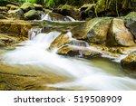 Waterfall In Mountain River...