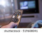 man watching television using... | Shutterstock . vector #519608041