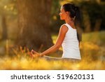 Stock photo young woman practicing morning meditation in nature at the park health lifestyle concept 519620131