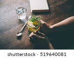 hands of young woman holding a... | Shutterstock . vector #519640081