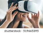 Stock photo future is now attractive young woman adjusting her vr headset and smiling while sitting at home 519665395