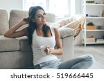 enjoying coffee at home.... | Shutterstock . vector #519666445