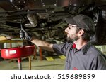 a mechanic working on car in... | Shutterstock . vector #519689899