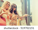 happy woman with shopping bags... | Shutterstock . vector #519702151