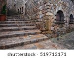 Spain, Catalonia, Tossa de Mar, medieval Old Town (Vila Vella), stairs and corner of a stone house